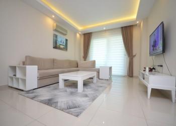 Стильная и полностью меблированная просторная 2 комнатная квартира на продажу в Алании