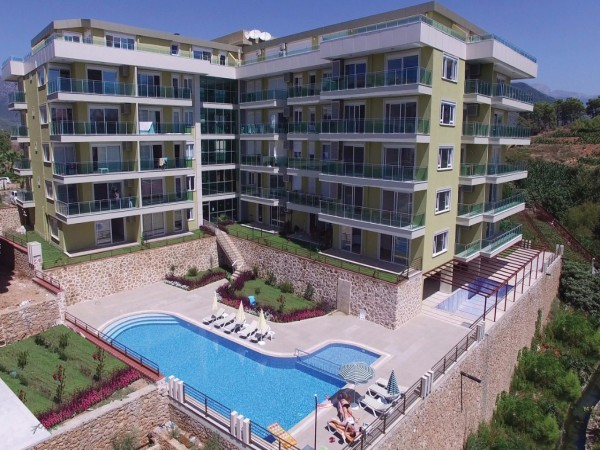 A unique hillside complex with stunning sea and mountain views in Kestel